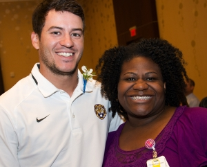 Former LSU placekicker Colby Delahoussaye honors everyday hero BRG Regional Burn Center Medical Director Dr. Tracee Short at BRG's Experience the Difference Luncheon.